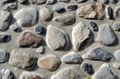 Stone wall. Wall of the house is built of stones Stock Photo