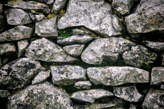 Stone Wall III. Grey textured stone wall with vignette effect Royalty Free Stock Photo