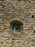 Stone wall inside with window. Old wall and small window in Istria near Slowenian border royalty free stock image