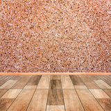 Stone wall interior with wood floor stock photography