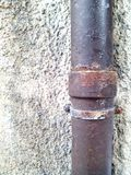 Stone wall with iron pipe texture Stock Images