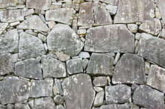 Stone wall in japanese castle Stock Photos