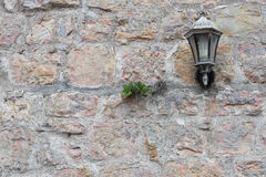 Stone wall with lantern Royalty Free Stock Photos