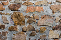 Stone wall from a large granite cobblestone . Royalty Free Stock Images