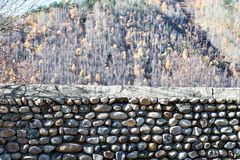 Stone wall. Laying of stones on a background autumn forest. Autu Royalty Free Stock Photos