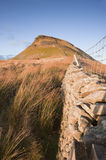 Stone wall leading up to Pen-y-Ghent in Yorkshire Dales National Stock Photography