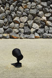 Stone wall with light cement light. Stock Photos