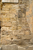 Stone wall limestone. Disrupted plaster coating stock photos