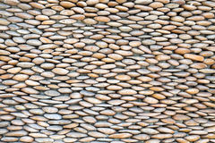 Stone wall, lined with pebbles Royalty Free Stock Image