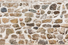 Stone wall made of different shape and size stones Royalty Free Stock Photo
