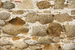 Stone wall. Made in the middle ages, the castle, illuminated by the sun, background, picture close-up Stock Photography