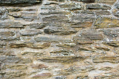 Stone wall. A stone wall made of schist fieldstone Stock Photos