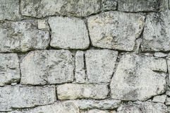 Stone wall made up from different sizes of limestones Stock Photos