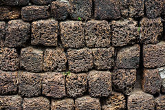 Stone wall made of volcanic pumice rock Stock Photo