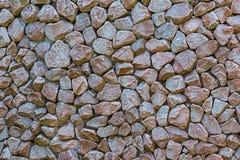 Stone wall many stone mini tiles cobblestones hard base wall background grunge style design background gray brown royalty free stock photo