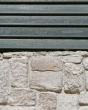Stone wall and metal bars fence Stock Image