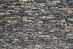 Stone wall of mixed slate. Stone wall detail, for construction, business, designers, home, interior and exterior decoration. Lakeland slate with mixed colours Stock Photography