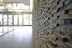 Stone wall in modern building Royalty Free Stock Photography