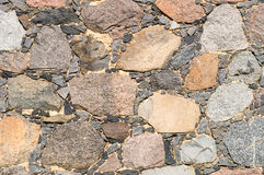 Stone wall, motley boulders Royalty Free Stock Photo