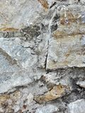 Stones that form a retaining wall. Stone wall of a mountain house located in Sierra Nevada, presenting a background of textures Royalty Free Stock Image