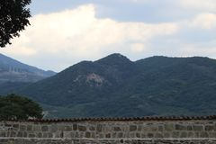 Stone wall and mountains outside