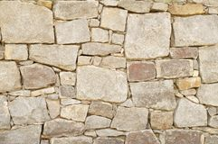 Stone wall. Multicolored, multishaped stone wall background Royalty Free Stock Photo