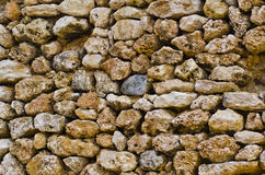 Stone Wall. Multiple colorful stones forming a stone wall in maltese countryside Stock Image