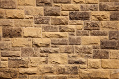 Stone wall of natural stones stock image