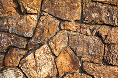Stone wall of natural stones. Fragment of a stone wall of natural stones background Stock Photography