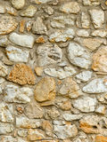 Stone wall, natural stones Stock Photos