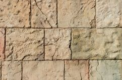 Stone wall of nude shades ideal for the background; Brick wall. Stone wall of nude shades ideal for the background; Element of rock wall Royalty Free Stock Photography