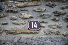 Stone wall and number fourteen Stock Photography
