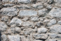 Stone wall. An Old stone wall backgrounds royalty free stock images