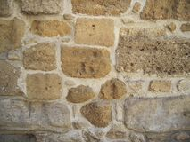 Stone wall of the old building, sand color, stone background. Stock Photography