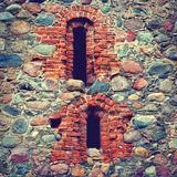 Stone wall of an old castle Stock Images