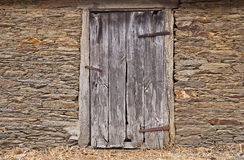Stone wall with old door Royalty Free Stock Photos