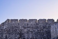 Stone wall of old fortress against sky Royalty Free Stock Photo