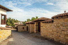 A stone wall and an old house from Arbanasi, Bulgaria. Royalty Free Stock Image
