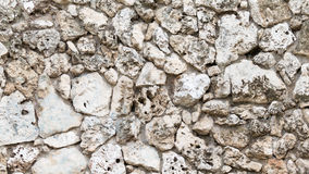 Stone wall of old natural tuff Stock Image