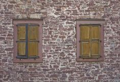 Stone wall with old windows Royalty Free Stock Photography