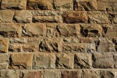 Hard and solid. This a stone wall in one of Mossel Bay`s stone buildings from the previous century. The wall is a testimony of excellent masonry. After a hundred Royalty Free Stock Photos