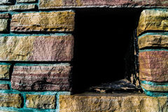Stone wall with opening in it Stock Photos