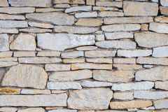 Stone wall. Outdoor background natural stone Royalty Free Stock Photography