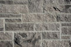 Stone wall pattern. Stone wall background ? different sizes of stones and cement stock images