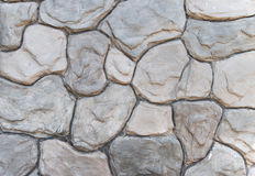 Stone wall pattern. Unshaped stone wall pattern, wall made of rocks Stock Photos