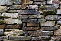 Stone wall pattern from old log cabin chimney.  Stock Image