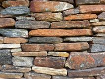 Stone wall pattern from old log cabin chimney. This is an exterior picture of a stone chimney from a log cabin Stock Image