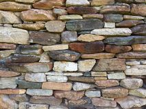 Stone wall pattern from old log cabin chimney Royalty Free Stock Image