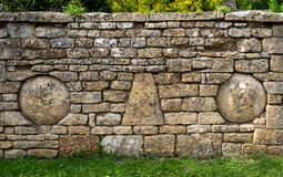 Stone wall in the pretty Cotswold village of Snowshill near Broadway in the English Cotswolds, Gloucestershire UK.