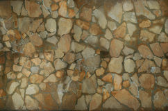 Stone wall puzzle texture background. Close-up puzzle texture background yellow and brown stone Stock Photography